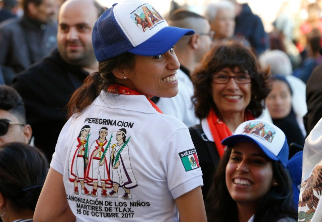 "Liliana Ayala Leonel from the Archdiocese of Tijuana, Mexico, wears a shirt with an image of the ""Child Martyrs of Tlaxcala"" before the canonization Mass of new saints celebrated by Pope Francis in St. Peter's Square at the Vatican Oct. 15. The pope canonized groups of martyrs from Mexico and Brazil, an Italian Capuchin priest and a Spanish priest. (CNS/Paul Haring)"