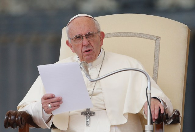 Pope Francis speaks during his general audience in St. Peter's Square at the Vatican Oct. 18. (CNS/Paul Haring)