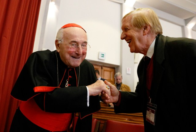 """German Cardinal Walter Brandmuller greets Professor Josef Seifert at a conference on Blessed Paul VI's 1968 encyclical, """"Humanae Vitae,"""" in Rome Oct. 28. The conference was organized by Voice of the Family, a coalition of pro-life and pro-family groups. (CNS/Paul Haring)"""