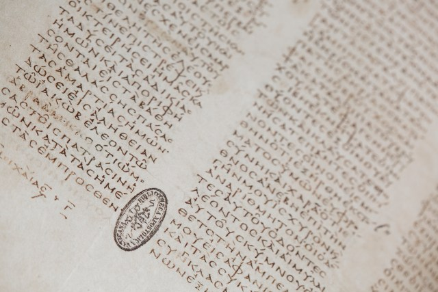 "A Codex Vaticanus manuscript from the 13th century is seen inside the ""Vatican Museums and Vatican Library"" exhibit at the Museum of the Bible in Washington. (CNS/Tyler Orsburn)"
