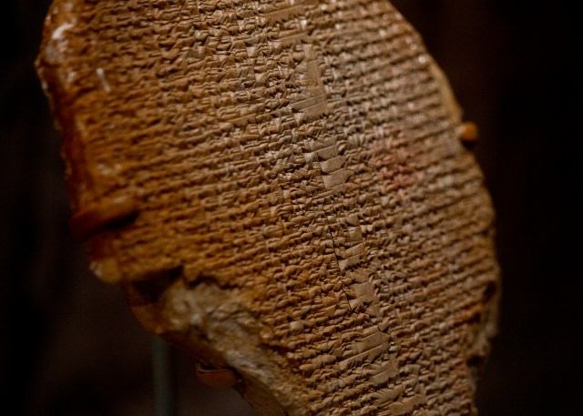 "The fragment of an Iraqi Gilgamesh dream tablet is seen inside the ""History of the Bible"" exhibit at the Museum of the Bible in Washington. It dates to around 1500 B.C. (CNS/Tyler Orsburn)"