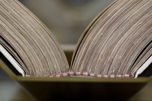 """A bound Codex Vaticanus manuscript from the 13th century is seen inside the """"Vatican Museums and Vatican Library"""" exhibit at the Museum of the Bible in Washington. (CNS/Tyler Orsburn)"""