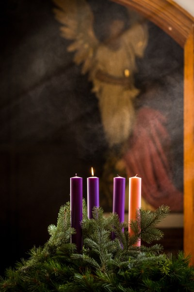 A lit candle is seen on an Advent wreath. Advent, a season of joyful expectation before Christmas, begins Dec. 3 this year. The Advent wreath, with a candle marking each week of the season, is a traditional symbol of the liturgical period. (CNS/Lisa Johnston, St Louis Review)