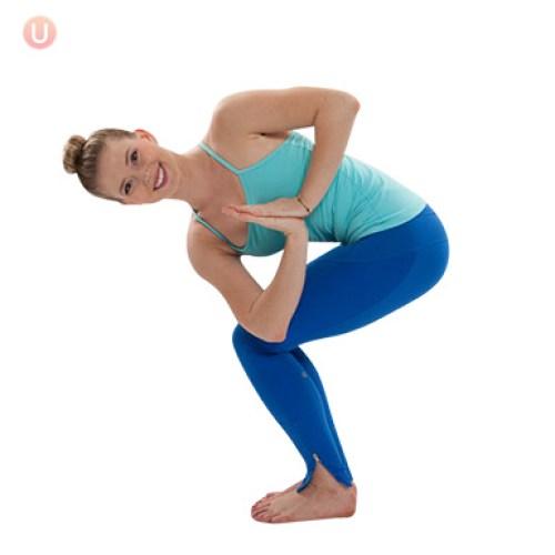 Twisted chair (parivrtta utkatasana) yoga pose