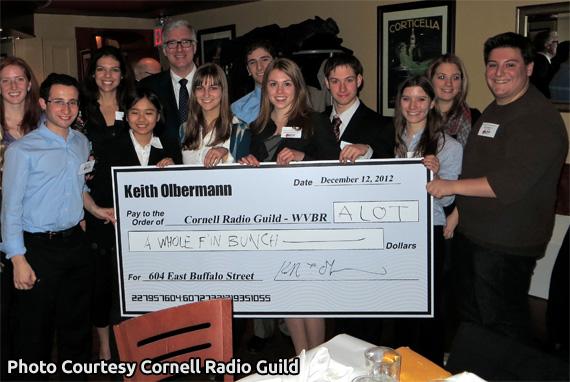 Keith Olbermann presents WVBR alumni with giant check for studio move, 2012