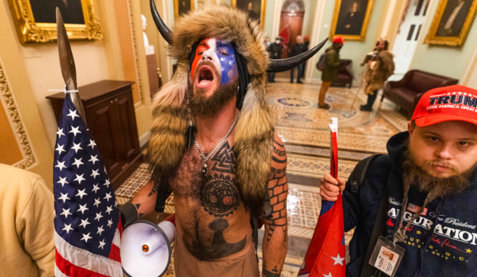 The  bearskin headdress and horned man in the Capitol last week is refusing to eat unless he's given an organic diet