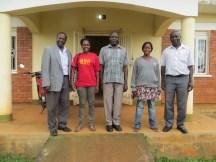L-R, Noah, Grace, Kibakinge (asst. district water engineer), Belinda, Nyonyi Paul (district water engineer) at the district office