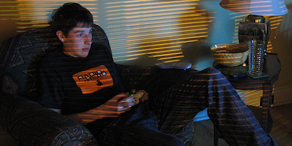Teen boy playing video games