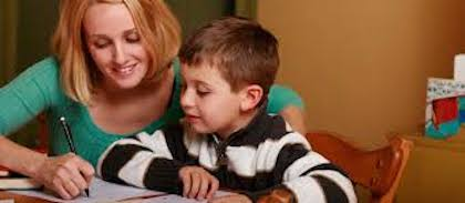 Mom helping boy with homework
