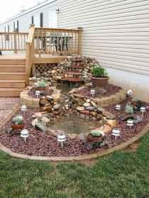 25 Stunning Backyard Ponds Ideas With Waterfalls (15)