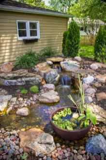 25 Stunning Backyard Ponds Ideas With Waterfalls (5)