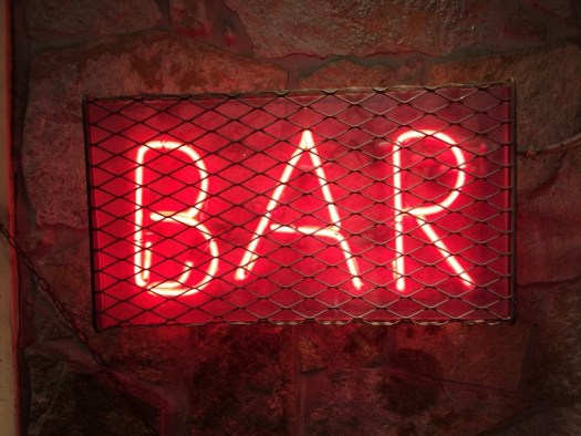 Neon sign that says bar
