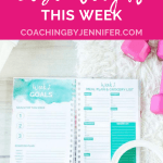 Open Well Journal on white background with pink dumbbells