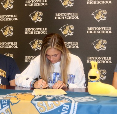 A high school senior signs her commitment to UCSC Track & Field