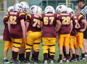 youth football offense huddle