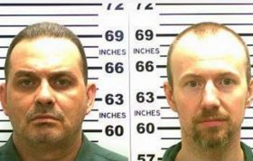 Manhunt for escaped murderers focuses on small New York town