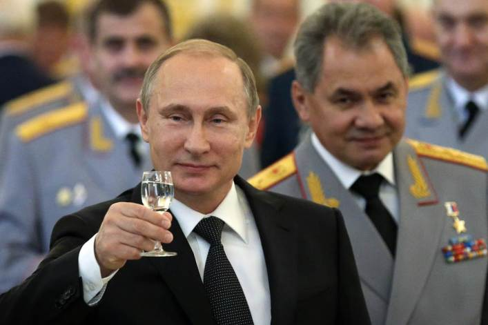 Russian President Vladimir Putin and Defense Minister Sergei Shoigu in June. Sasha Mordovets / Getty Images