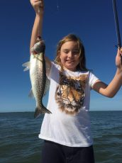 Granddaughter on a charter with her Grandfather and Fish Face Charters