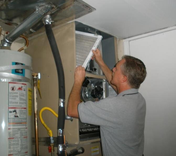 A Home Inspector Checks the Furnace