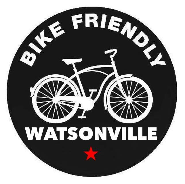 Bike Friendly Watsonville white text on black circle with a white cruiser bicycle