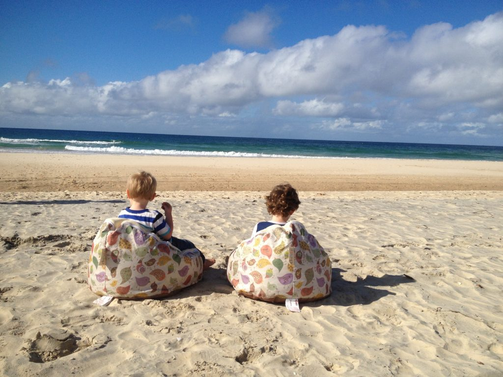 Children on bean bags on the beach - Family Travel Australia