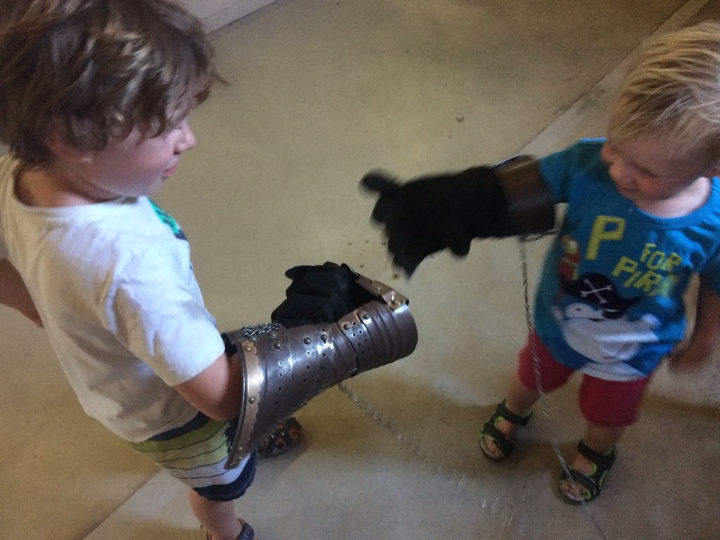 The boys fighting with gauntlets