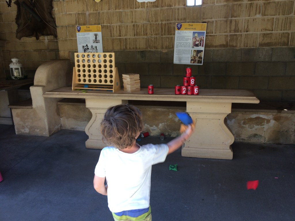 A boy playing knock em down at Sunshine Castle