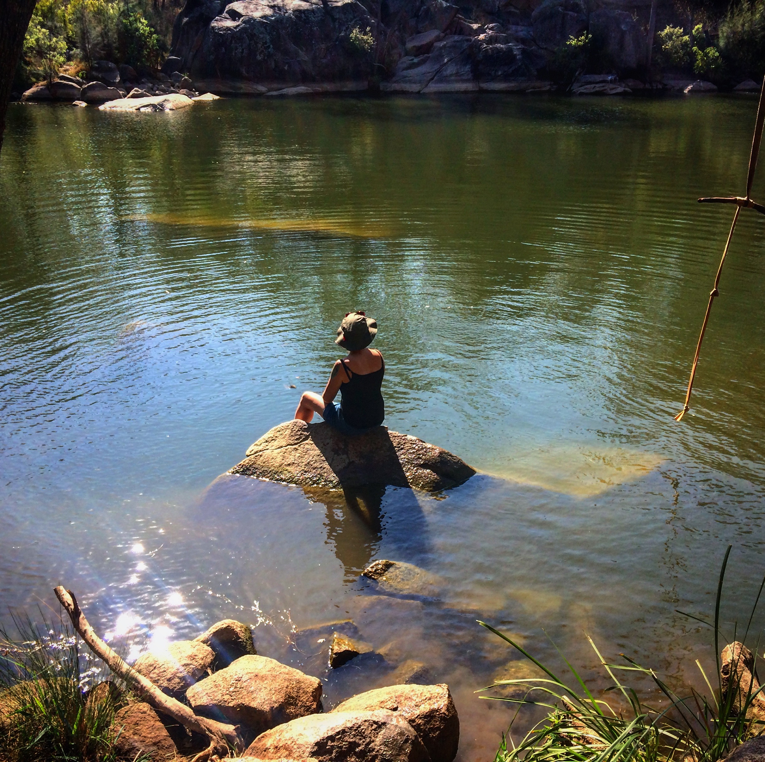 Me sitting at a beautiful hidden waterhole that we found on our journey