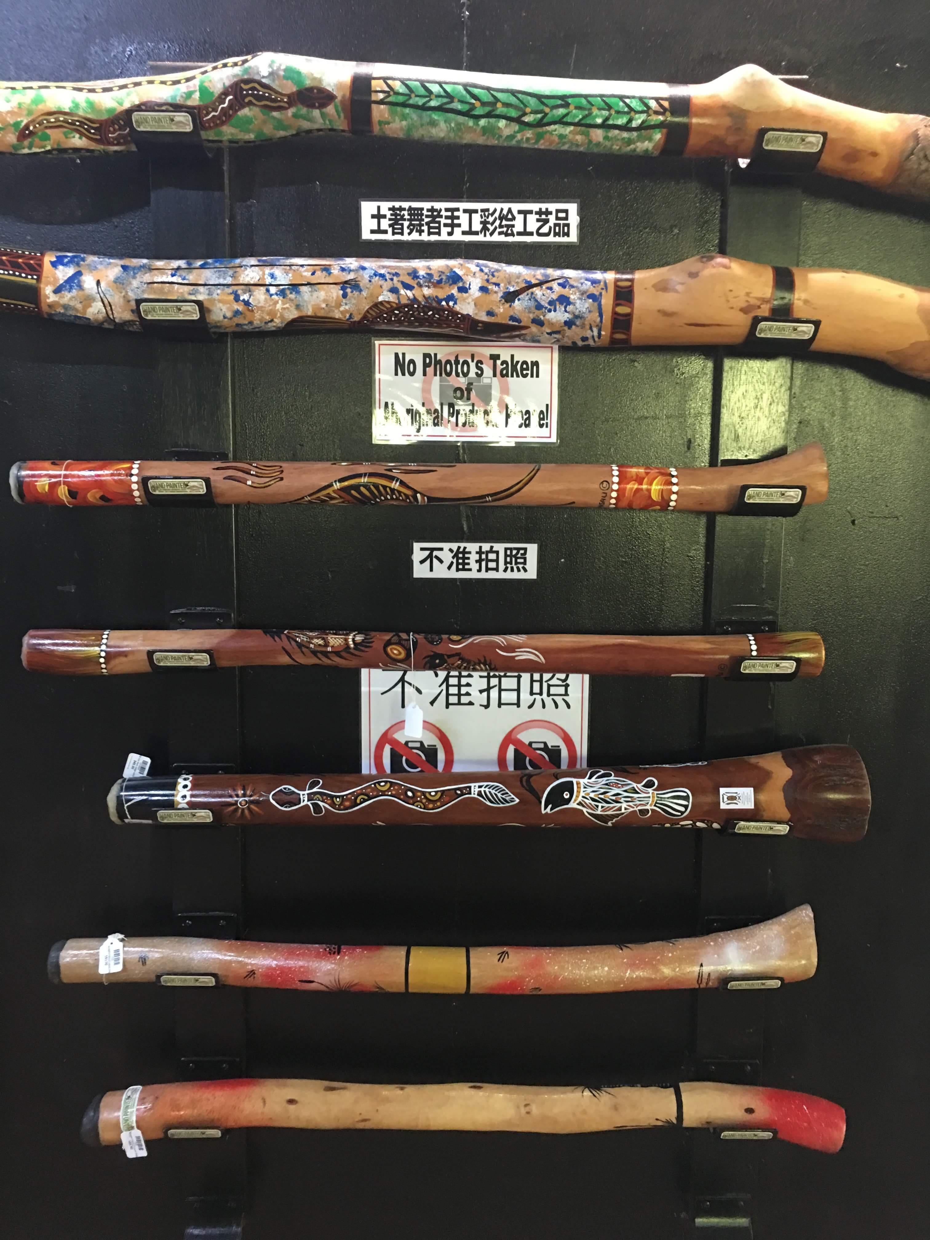 A display of indigenous hand painted didgeridoos