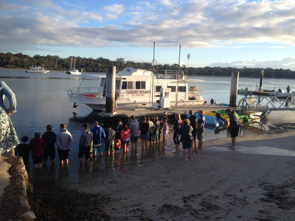 A small crowd waiting at Snapper's Creek for wild dolphin feeding.