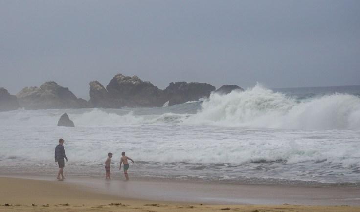 Dad puts an end to children wading near 12 ft waves at Garrapata State Beach. Dawn Page/CoastsideSlacking