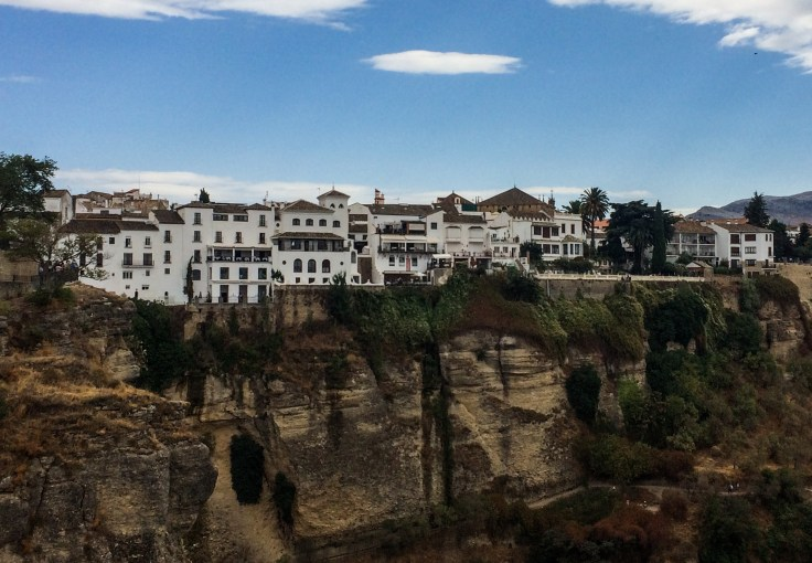 The village of Ronda is perched atop dizzying cliffs, famously described in Hemingway's For Whom the Bell Tolls. Andalusia, Spain. Dawn Page / CoastsideSlacking