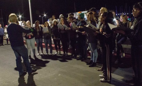 HBM High School provides entertainment at the Pillar Point Harbor Lighted Boat Festival. Dawn Page / CoastsideSlacking