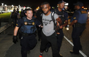 http://www.wsj.com/articles/black-lives-matter-activist-arrested-in-baton-rouge-protest-1468149676