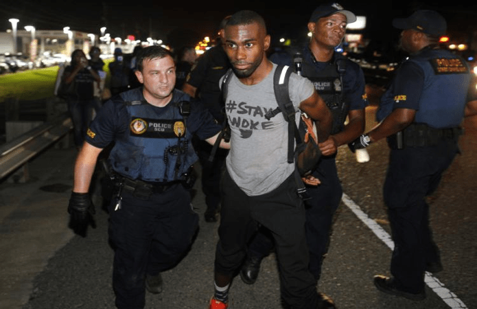 http://www.wsj.com/articles/black-lives-matter-activist-arrested-in-baton-rouge-protest-1468149676