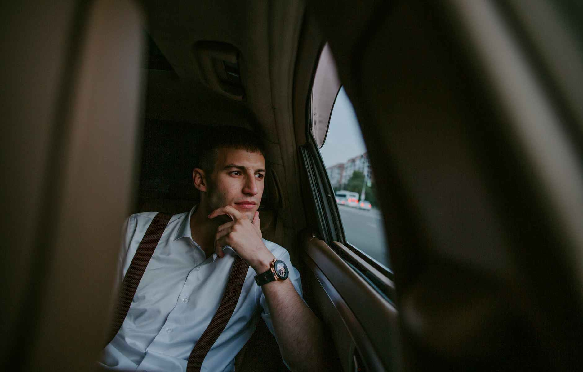 man sitting in car with leather interior