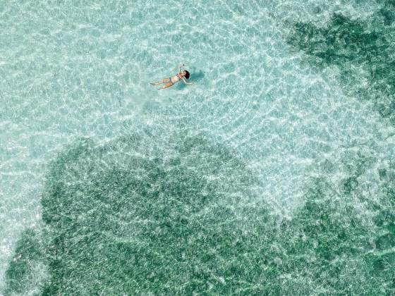 teal water woman swimming