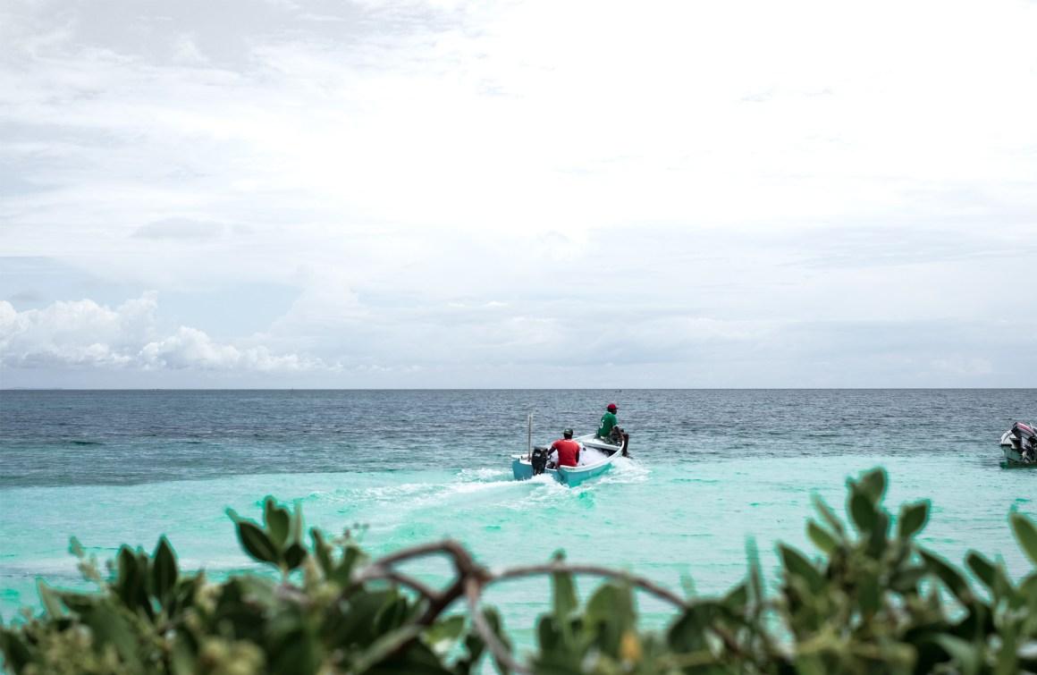 fisherman boat teal water