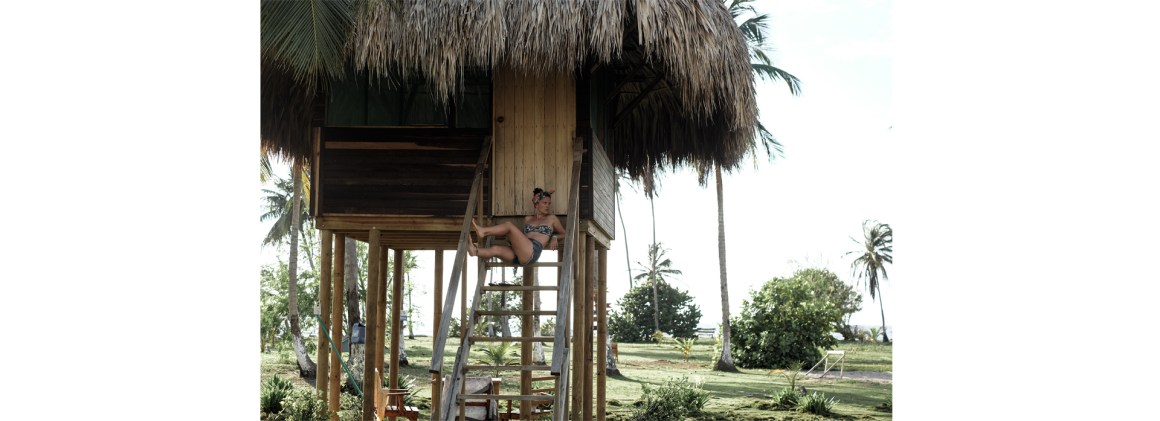 woman hut palm trees bikini