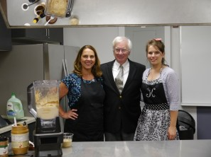 Joe Phillips, M.D. was all smiles during WellStar Kennestone Hospital's ribbon cutting celebration for its new cardiac rehabilitation services demonstration kitchen. Phillips participated in an interactive healthy cooking demonstration led by JoLynn Montamat, R.D., L.D. and Kayla Perry, R.D.N., L.D. Pictured (left to right): Jolynn Montamat, Joe Phillips, Kayla Perry