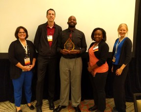 Pictured from left to right: Michelle Girage, assistant dean; Jason Brown, copywriter; Jermile Richards, Health Coach certificate graduate and recipient of UPCEA Continuing Education Student Award; Davia Rose Lassiter, marketing director; Cheryl Rodewig, social media specialist.
