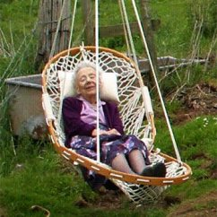 Hammock Chair Reviews Baby Rocking Chairs Casual Outdoor Furniture Cobble Mountain A Woman Dozes In An Original