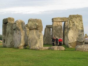 Tourists standing within the Stonehenge circle