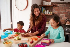 mom making lunch with kids