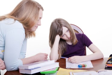Child struggling with homework because of ADHD