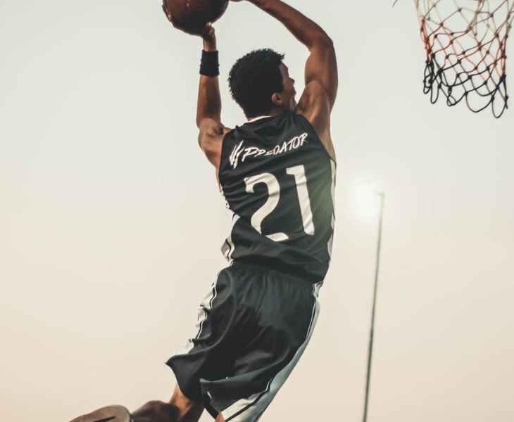 photo of man doing dunk