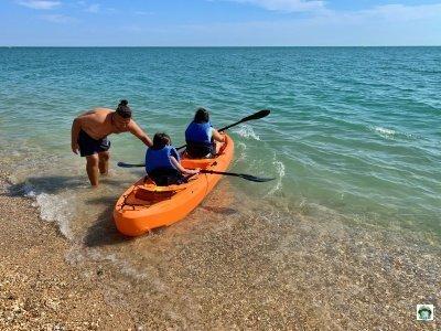 bambini canoa mare Riviera Conero