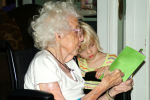reading-with-grandmother-in-wheelchair-801960-m