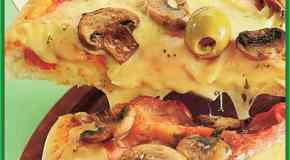 Pizza de jamón y champiñones