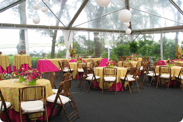 Bamboo chairs with pink and paisley table linens for wedding reception